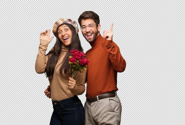 Jong koppel in valentijnsdag dansen en plezier hebben