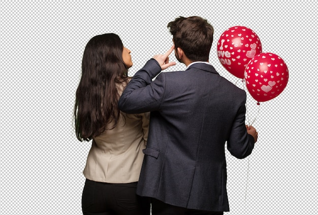 Jong koppel in valentijnsdag van achter nadenken over iets