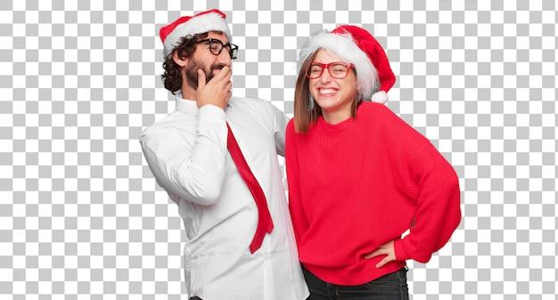 Jong paar die kerstmisconcept uitdrukken. paar en achtergrond in verschillende lagen
