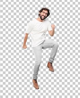 Jonge, bebaarde zakenman blazer dansen expressie dragen