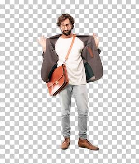 Jonge, bebaarde zakenman blazer dragen. trots of succesuitdrukking
