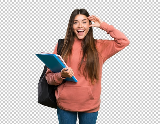 Jonge de holdingsnotitieboekjes van de studentenvrouw met verrassingsuitdrukking