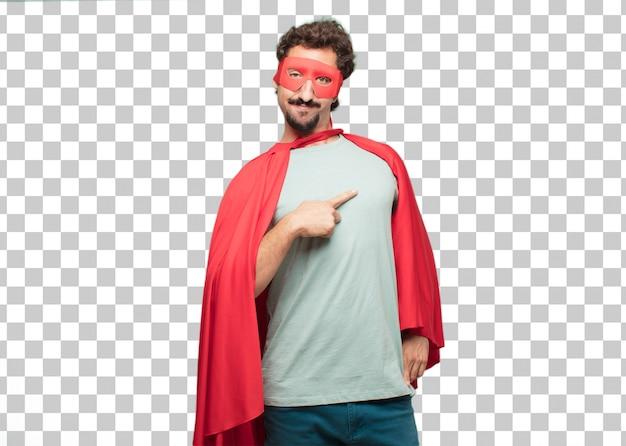 Jonge gekke super heldenmens die en gebaar richt toont