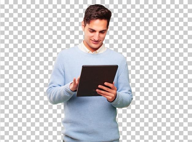 Jonge knappe gebruinde man met een tablet van het aanrakingsscherm