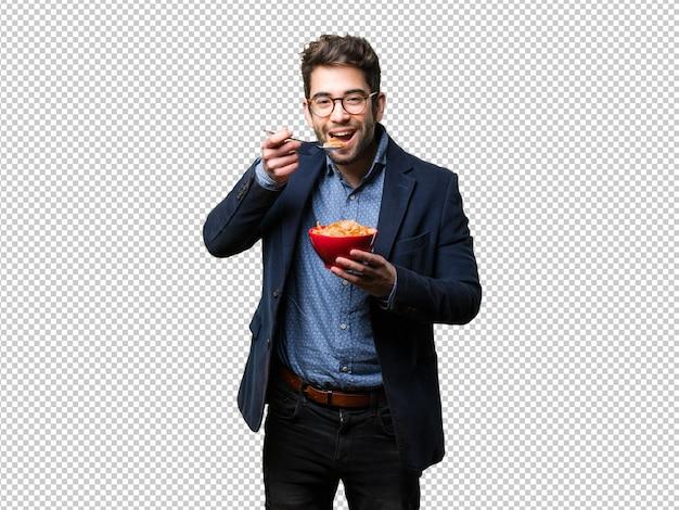 Jonge man met een kom cornflakes