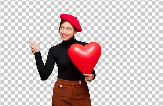 Jonge mooie vrouw die liefdeconcept uitdrukken voor valentijnskaartendag
