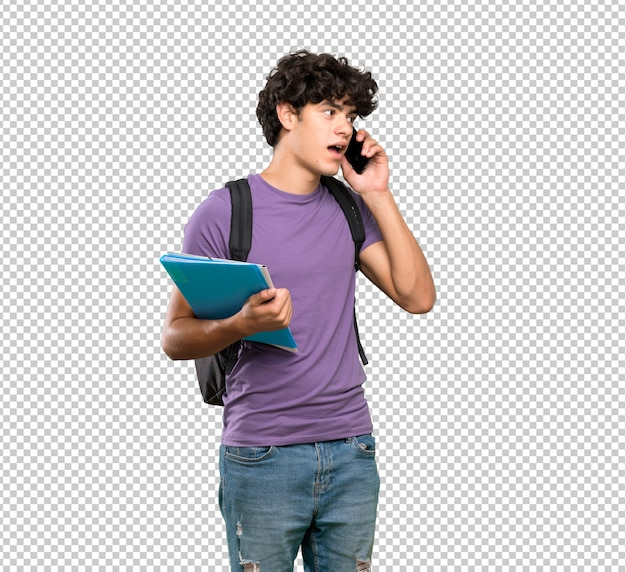 Jonge studentenmens die een gesprek met de mobiele telefoon houden