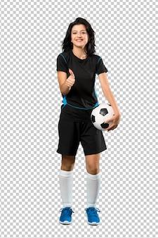 Jonge voetbalstervrouw met duimen omhoog omdat iets goed is gebeurd