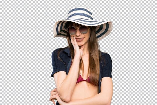 Jonge vrouw in bikini lachen