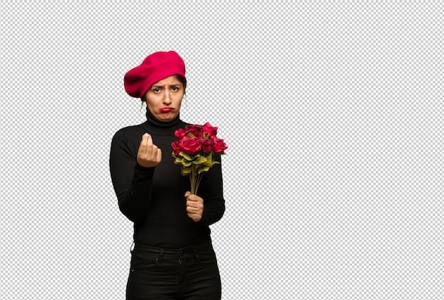 Jonge vrouw in valentijnsdag doet een gebaar van behoefte