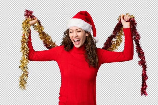 Jonge vrouw met kerstmuts