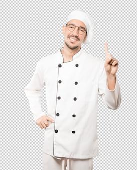 Joven chef haciendo un gesto número uno