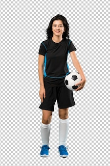 Joven futbolista mujer sonriendo mucho