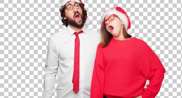 Joven pareja expresando el concepto de navidad pareja y fondo en diferentes capas.