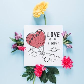 Kaart mockup met bloemen valentijnsdag concept Gratis Psd