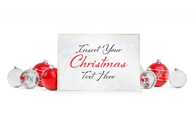 Kerstkaart op wit oppervlak met kerstballen sjabloon