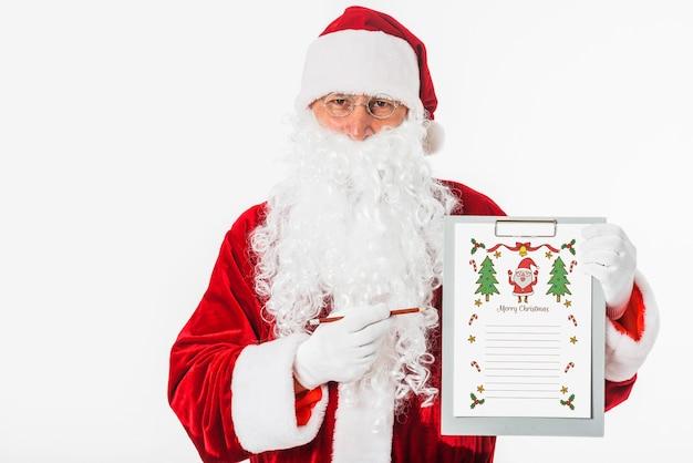 Kerstman die klembord met wishlist houden