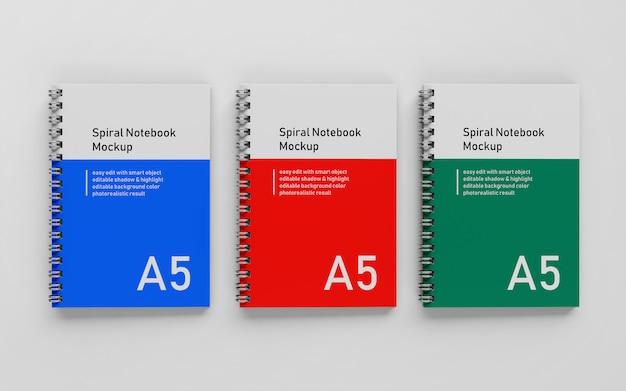 Klaar om te gebruiken triple bussiness hard cover a5 spiraal binder notepad mock up ontwerpsjabloon in bovenaanzicht