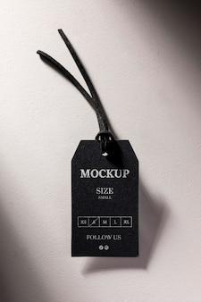 Kleding zwart maat tag mock-up plat leggen