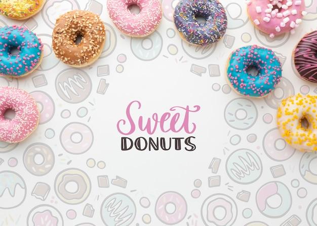 Kleurrijke donutsregeling met model