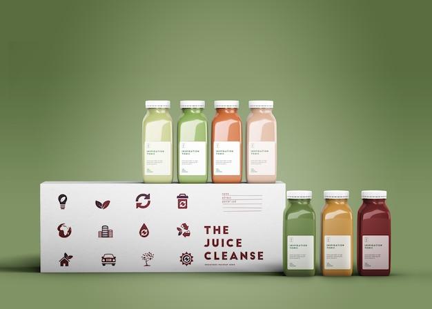 Kleurrijke smoothies met groen model als achtergrond