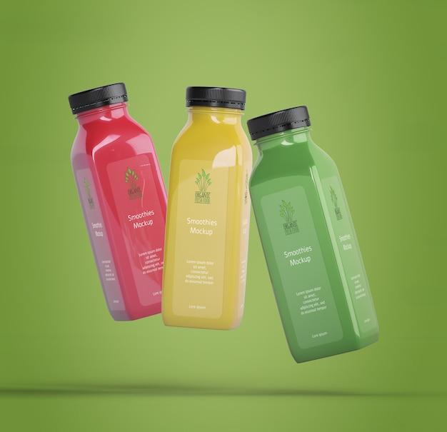 Kleurrijke smoothies op groene achtergrond