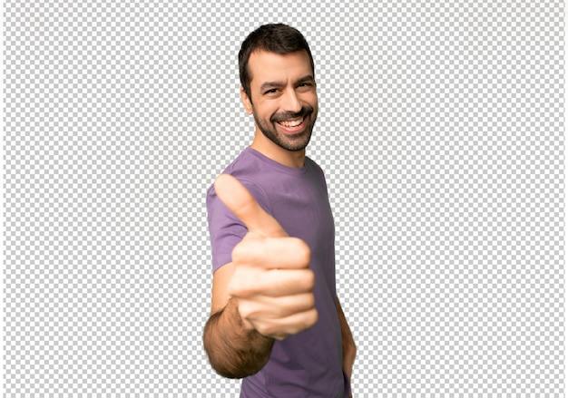 Knappe man die een duim omhoog gebaar geeft omdat er iets goeds is gebeurd