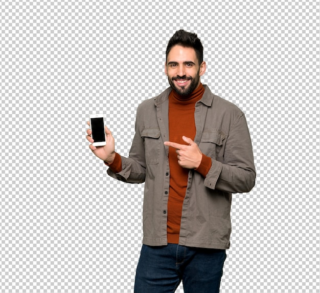 Knappe man met baard gelukkig en wijst de mobiel