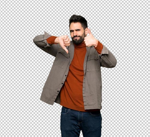 Knappe man met baard goed-slecht teken maken. onbeslist tussen ja of nee