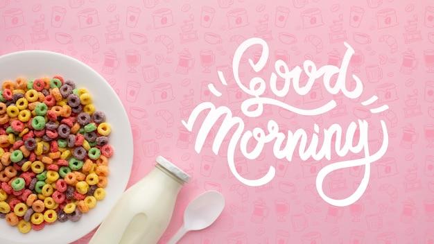 Kom met ontbijtgranen en fles met melk