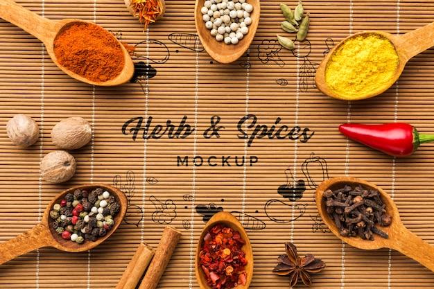 Kruiden en specerijen mock-up omgeven door lepels gevuld met levensmiddelen