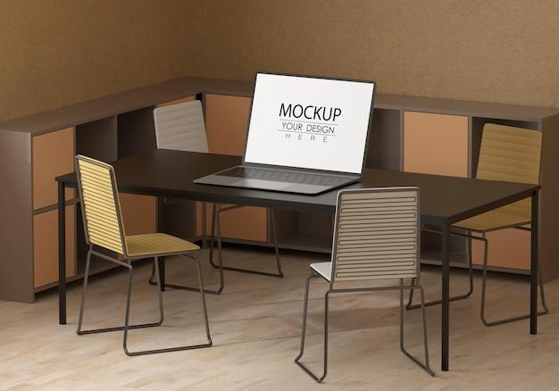 Laptop en escritorio en maqueta de espacio de trabajo PSD Premium