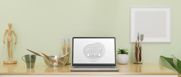 Laptop met mockup-scherm op de werkruimte van de kunstenaar met tools en decoraties 3d-rendering