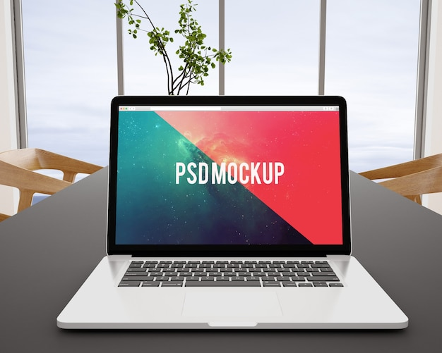 Laptop op zwart bureau bespot