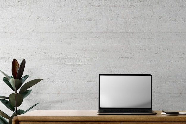 Laptop scherm mockup psd op een bureau loft thuiskantoor zone
