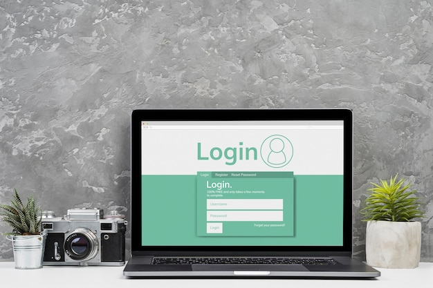 Laptop van het vooraanzichtmodel met cementachtergrond