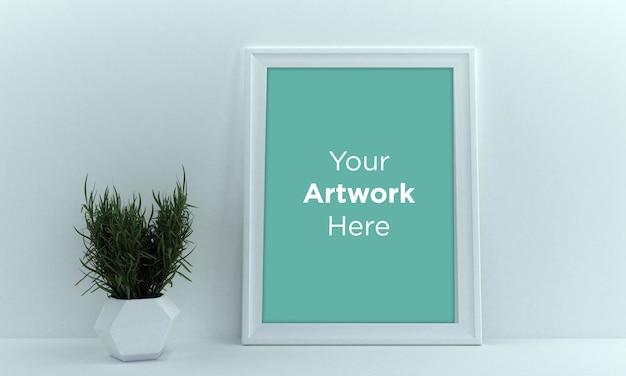 Leeg fotolijst mockup design met groene plant