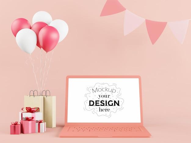Leeg scherm laptopcomputer in verjaardagsfeestje