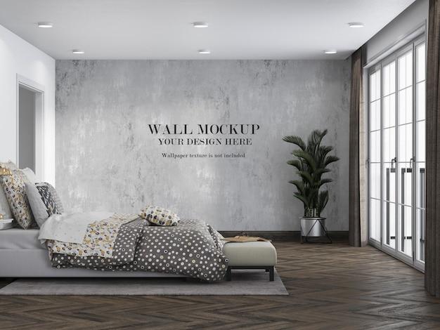 Lege muur voor het ontwerpen van slaapkamer met minimalistisch meubilair