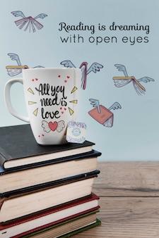 Leggere è sognare con la citazione di occhi aperti e una pila di libri