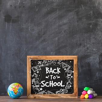 Leisteenmodel met terug naar schoolconcept