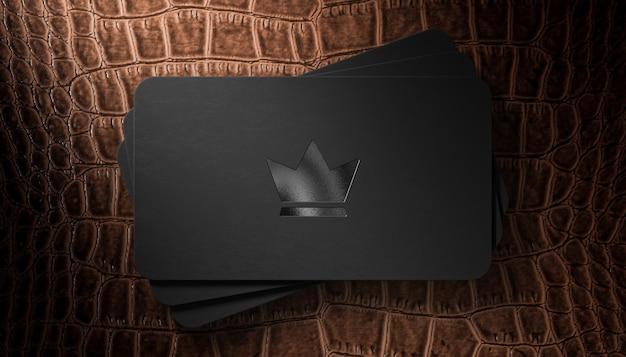 Letterpress logo mockup op zwart visitekaartje