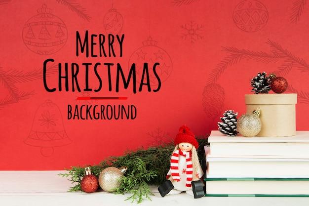 Libro de feliz navidad con libros y bolas de navidad