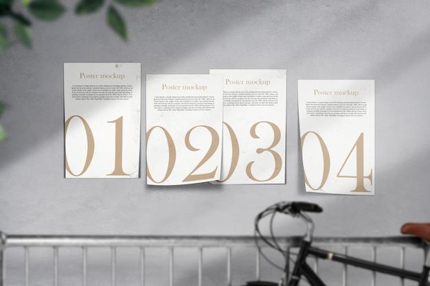 Limpie la maqueta mínima del cartel en la pared de ladrillo gris y la sombra ligera.
