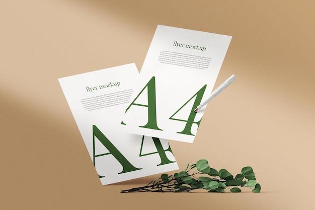 Limpie la maqueta mínima de papel a4 flotando con bolígrafo y hojas de fondo. archivo psd.