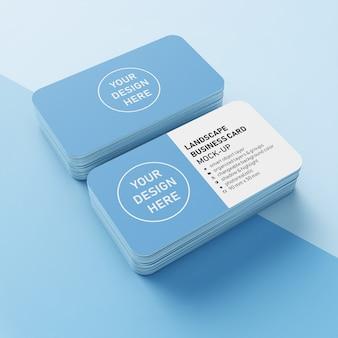 Listo para usar plantillas de diseño de maqueta de dos tarjetas de presentación apiladas de negocios de paisaje realista de 90x50 mm con esquinas redondeadas en la vista superior