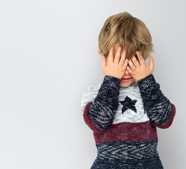 Little boy hands hidden face