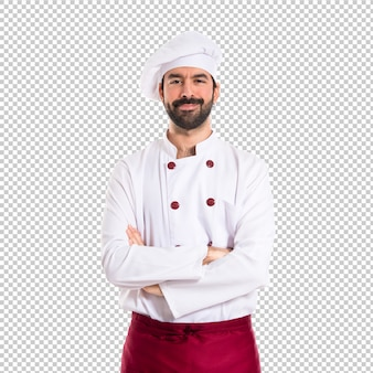 Lo chef con le braccia incrociate su sfondo bianco