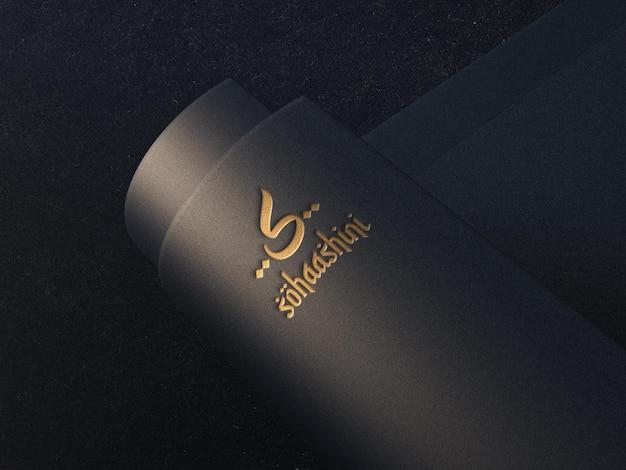 Logo ingeslagen op gebogen papieren mockup