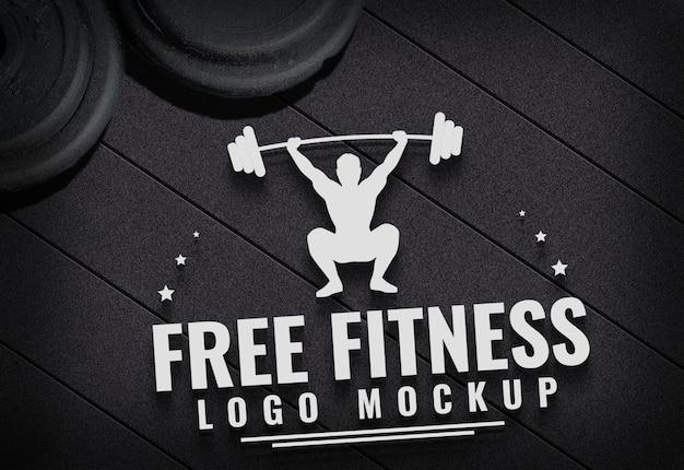 Logo libero di forma fisica derida sul fondo del tappeto della palestra